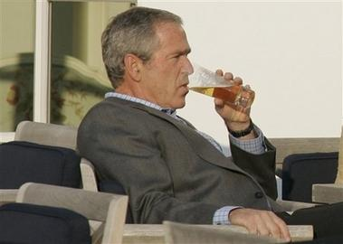 bush drinking beer